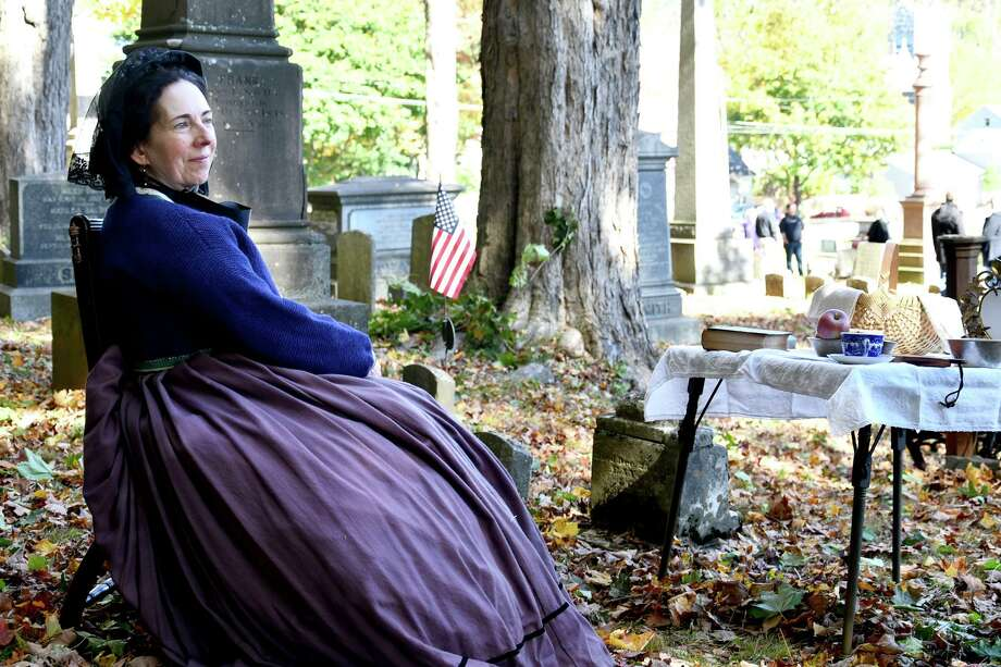The Winchester Soldier's Monument committee held a haunted cemetery walk event at Saturday in Winsted. Above, Deb Kessler portrays Charlotte Coe, who traveled incognito to assist the Underground Railroad. Photo: Lara Green-Kazlauskas / For Hearst Connecticut Media