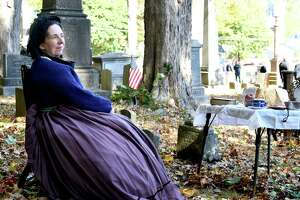 The Winchester Soldier's Monument committee held a haunted cemetery walk event at Saturday in Winsted. Above, Deb Kessler portrays Charlotte Coe, who traveled incognito to assist the Underground Railroad.