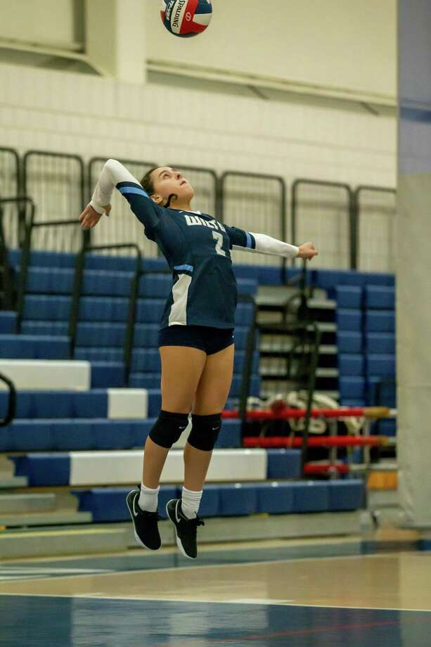 Gillian Lipsky hits a jump-serve during the Wilton girls volleyball team's 3-0 sweep of Bridgeport Central last week. It was the first win for the Warriors following 12 straight losses to start the season. Photo: Gretchen McMahon / For Hearst Connecticut Media