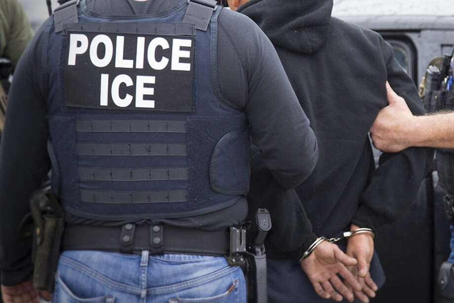 In this file photo released by U.S. Immigration and Customs Enforcement, a foreign national is arrested by U.S. Immigration and Customs Enforcement. Photo: Via AP
