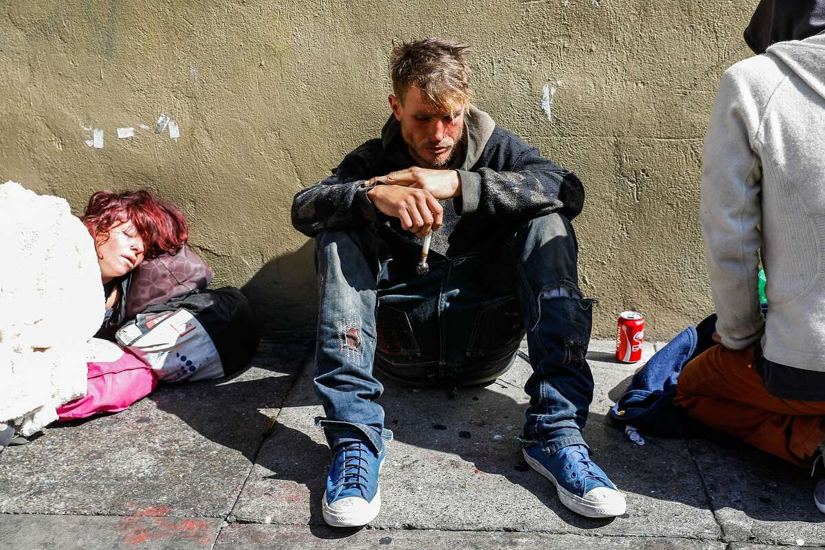 A man who went by Tagalong holds his meth pipe on Taylor Street in San Francisco, California, on Monday, Oct. 14, 2019.