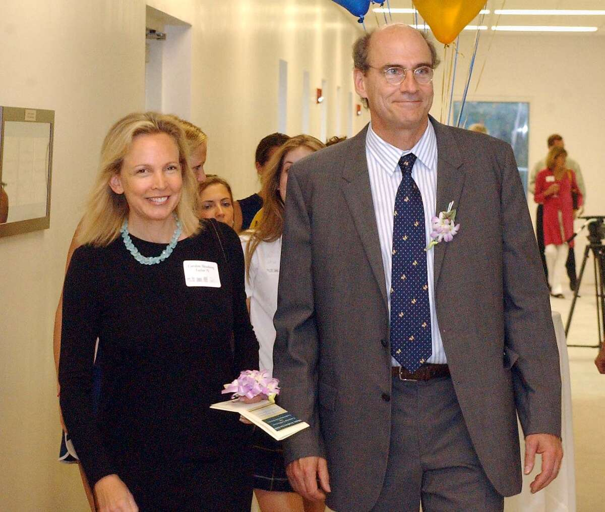 Kim Hessberg Taylor, an Albany Academy for Girls graduate, and her husband, singer/songwriter James Taylor, walk the halls of the new $3 million dollar athletic facility unveiled at the Albany Academy for Girls May 13, 2004. (Times Union Photo by James Goolsby)