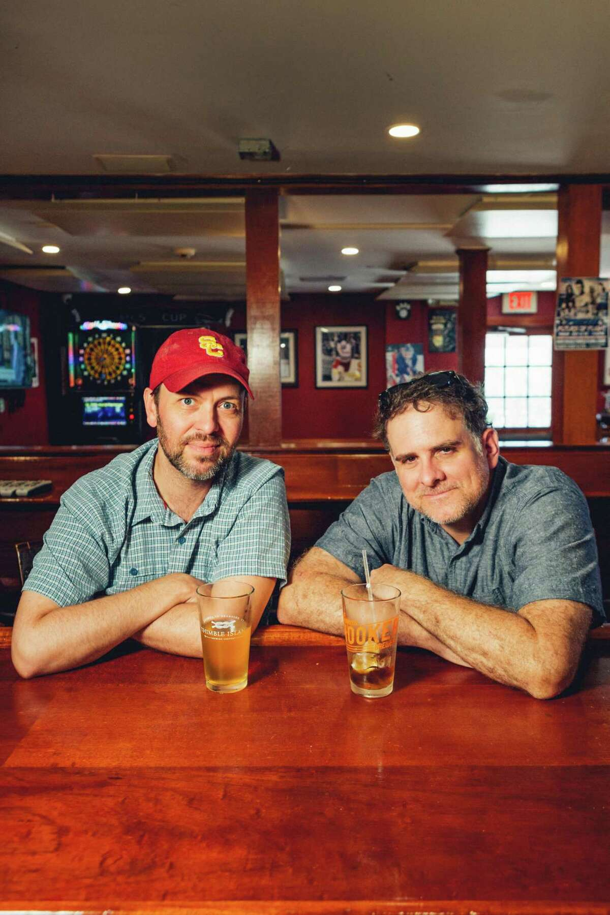 Thrown Stone Theater Company co-artistic directors from left to right Jonathon Winn and Jason Peck drinking a cold beer at Tiger's Den of Ridgefield, CT.