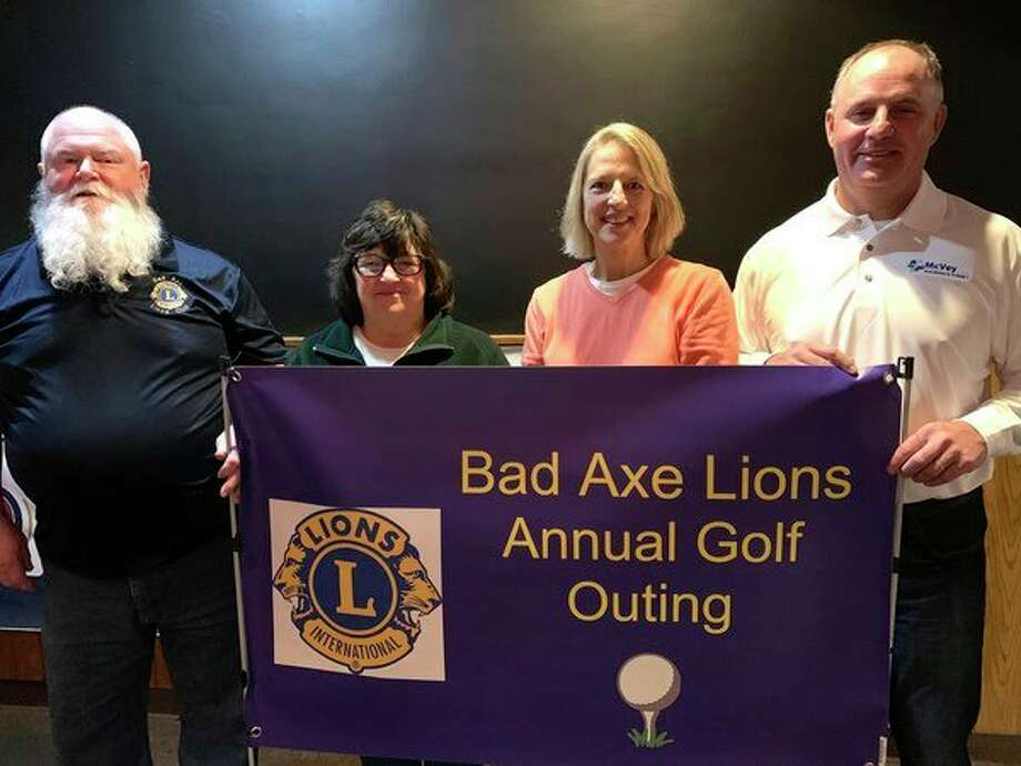 Pictured are Craig Harris, Bad Axe Lions Club president, Patti Errer, Huron County 4-H program coordinator, Mary Aymen, Huron County 4-H Council president and Sean McVey, Bad Axe Lions Club Annual Golf Outing chairperson. (Submitted Photo)