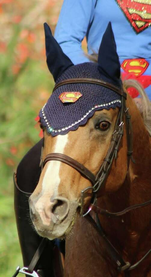 """A horse and rider with a superhero theme at Newtown Bridle Lands Association's Halloween themed """"Frost on the Pumpkin"""" Hunter Pace, which will be held on Saturday. Photo: Contributed Photo / Contributed / The News-Times Contributed"""
