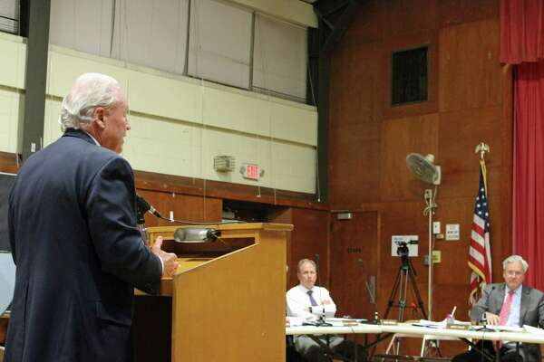 Board of Finance member James Walsh and First Selectman Mike Tetreau went head-to-head over the town's communications consultant contract.