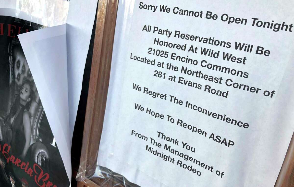 A sign on the front of Midnight Rodeo's doors indicates the club hopes to reopen soon, but a manager for the operator said Monday it has no plans to resume operations. The operator wants to liquidate the business in bankruptcy.