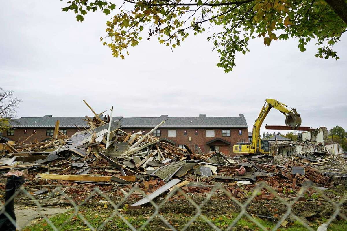 Demolition work continues on a section of the apartments at Yates Village on Tuesday, Oct. 22, 2019, in Schenectady, N.Y. The site is being redeveloped with new apartments being built. (Paul Buckowski/Times Union)