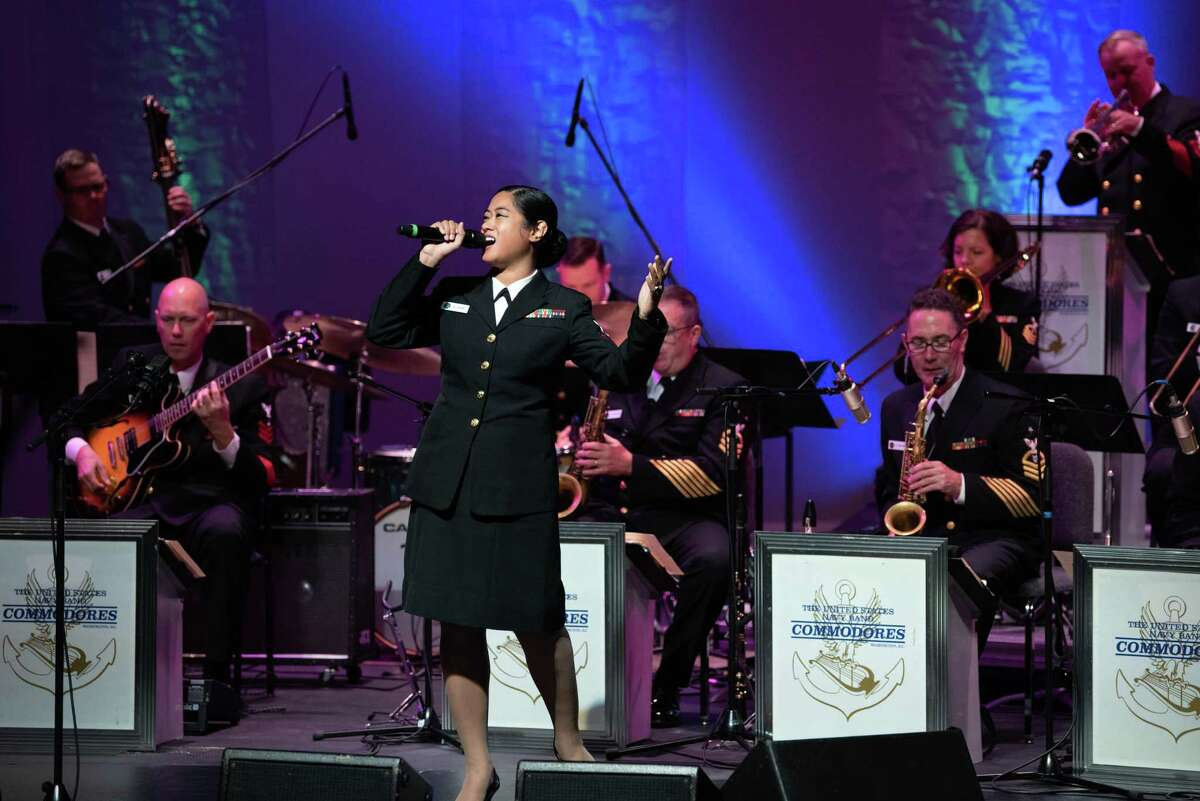 Musician 1st Class Kristine Hsia sings with the U.S. Navy Band Commodores jazz ensemble during a concert in 2018; the group is due in New Haven Nov. 3.