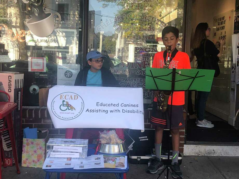 "Tyler Hilford and Aakarsh Patel, left to right, perform as the ""Musical Rescuers"" in front of Kafo on Main Street. Photo: Contributed Photo"