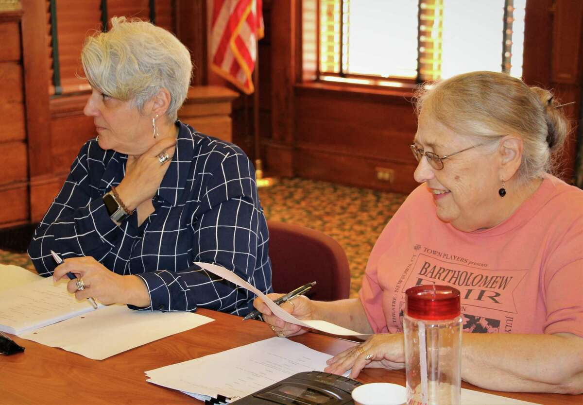 Gaetana Barbano-Grinder, of Milford, costumes; and Ruth Anne Baumgartner,Fairfield, at a table read for