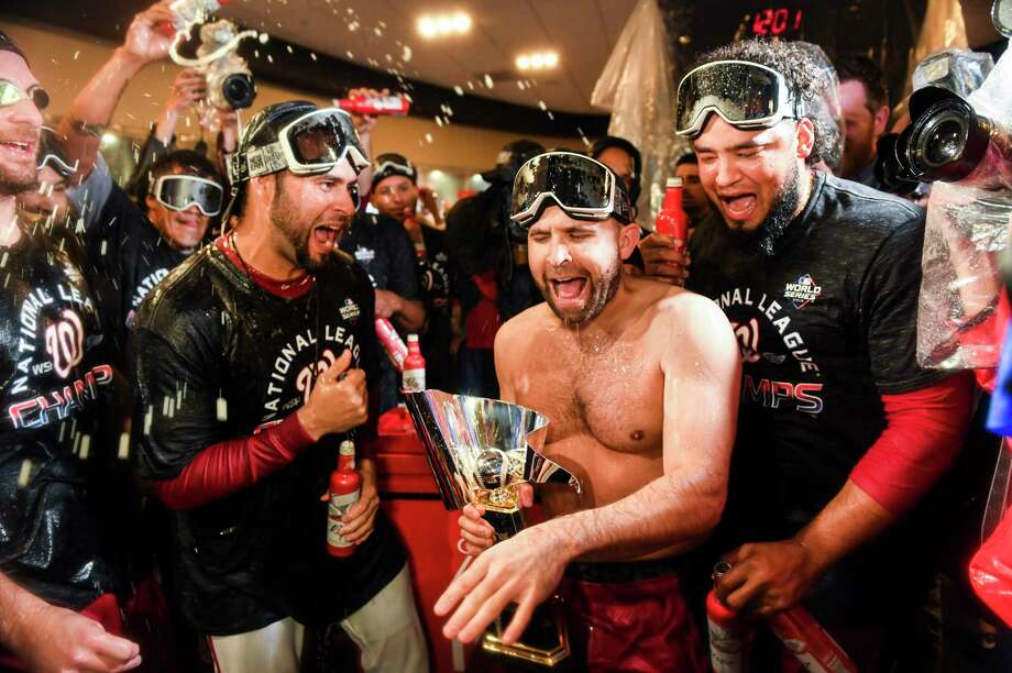 (L-r) Aníbal Sanchez, Brian Dozier and Raudy Read of the Washington Nationals celebrate Oct. 16 in the locker room after winning Game Four of the NLCS against the St. Louis Cardinals at Nationals Park. Photo: Washington Post Photo By Toni L. Sandys / The Washington Post