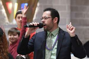 Rabbi Kevin Peters sings during the Erev Simchat Torah Celebration at Temple Sholom in Greenwich, Conn. Monday, Oct. 21, 2019. The celebration marks the culmination of Sukkot and Shemini Atzeret and the conclusion of the annual Torah reading cycle. The event for all agesl included a parade of the Torahs, dancing, singing, trivia and more.