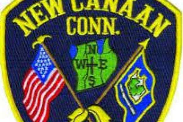 Pictured is a New Canaan Police Department badge.