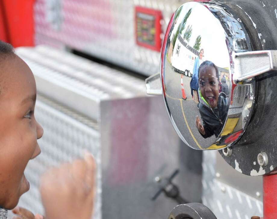 Schools in the Greater New Milford area offered numerous special programs, assemblies and educational opportunities beyond everyday learning to students. Northville Volunteer Fire Department visited Northville Elementary School in October to educate students about fire safety. Levi Denton was joyful as he discovered his reflection on one of the fire trucks. Photo: Deborah Rose / Hearst Connecticut Media / The News-Times  / Spectrum