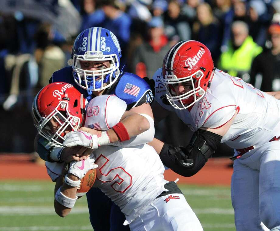 Scenes from the 2017 Turkey Bowl game between the Darien and New Canaan football teams at Stamford's Boyle Stadium. Photo: Bob Luckey Jr. / Hearst Connecticut Media / Greenwich Time