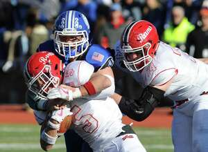 Scenes from the 2017 Turkey Bowl game between the Darien and New Canaan football teams at Stamford's Boyle Stadium.