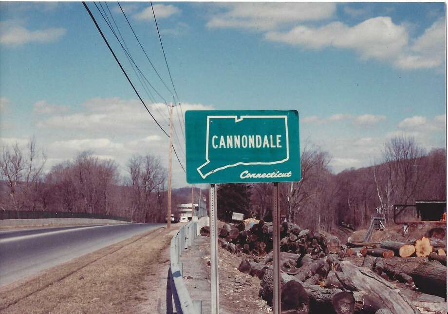 An old, undated photo shows a sign indicating the beginning of Cannondale at Gregory's Sawmill on Danbury Road. Photo: Contributed Photo / Peter Snyder / Wilton Bulletin Contributed