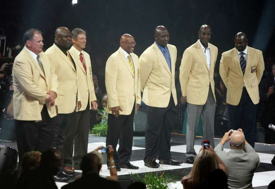 The Pro Football Hall of Fame Class of 2010 gather for the first time with their gold blazers that were presented to them at the Hall of Fame Festival Enshrinees Dinner at the Canton Civic Center Friday, Aug. 6, 2010 in Canton, Ohio. From left are: Russ Grimm, Rickey Jackson, Dick LeBeau, Floyd Little, John Randle, Jerry Rice and Emmitt Smith. The seven NFL greats will be inducted into the Pro Football Hall of Fame Saturday. Photo: Scott Heckel