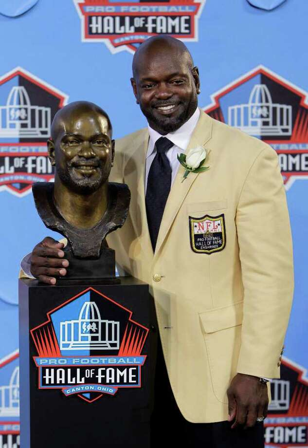 Former Dallas Cowboys player Emmitt Smith poses with a bust of himself after enshrinement in the Pro Football Hall of Fame in Canton, Ohio, Saturday, Aug. 7, 2010. Photo: Mark Duncan