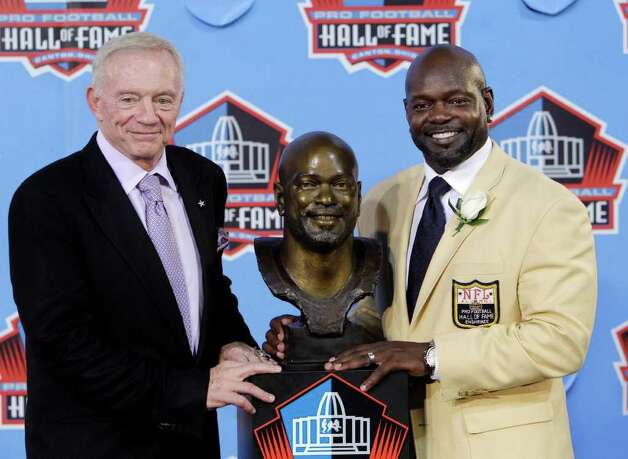 Former Dallas Cowboys great Emmitt Smith, right, poses with Cowboys owner Jerry Jones after Smith's enshrinement in the Pro Football Hall of Fame in Canton, Ohio Saturday, Aug. 7, 2010. Photo: Mark Duncan