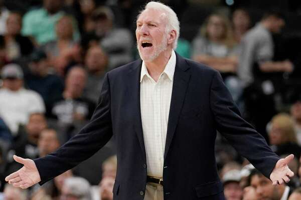 San Antonio Spurs head coach Gregg Popovich yells at a referee during the first half of an NBA preseason basketball game against the Memphis Grizzlies, Friday, Oct. 18, 2019, in San Antonio. (AP Photo/Darren Abate)
