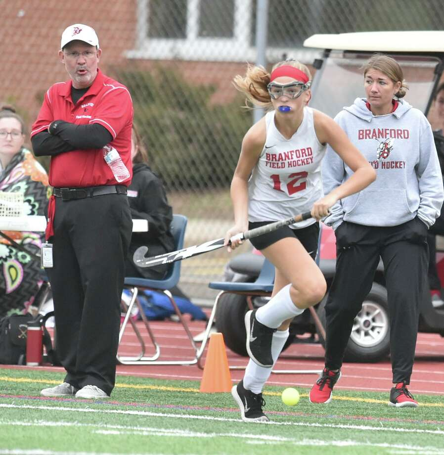 Branford field hockey coach Peter Frye, left, says the Hornets challenging schedule gives his team ample opportunity to improve and prepare for the postseason. Photo: Peter Hvizdak / Hearst Connecticut Media / New Haven Register