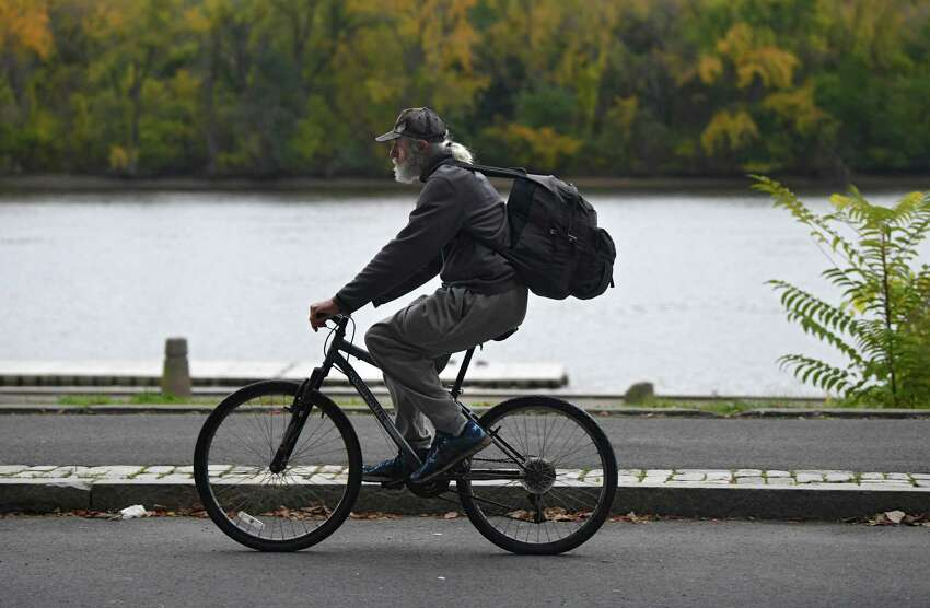 A cyclist rides along the bike path at the Corning Preserve on Tuesday, Oct. 22, 2019 in Albany, N.Y. (Lori Van Buren/Times Union)