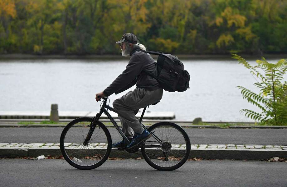 A cyclist rides along the bike path at the Corning Preserve on Tuesday, Oct. 22, 2019 in Albany, N.Y. (Lori Van Buren/Times Union) Photo: Lori Van Buren, Albany Times Union
