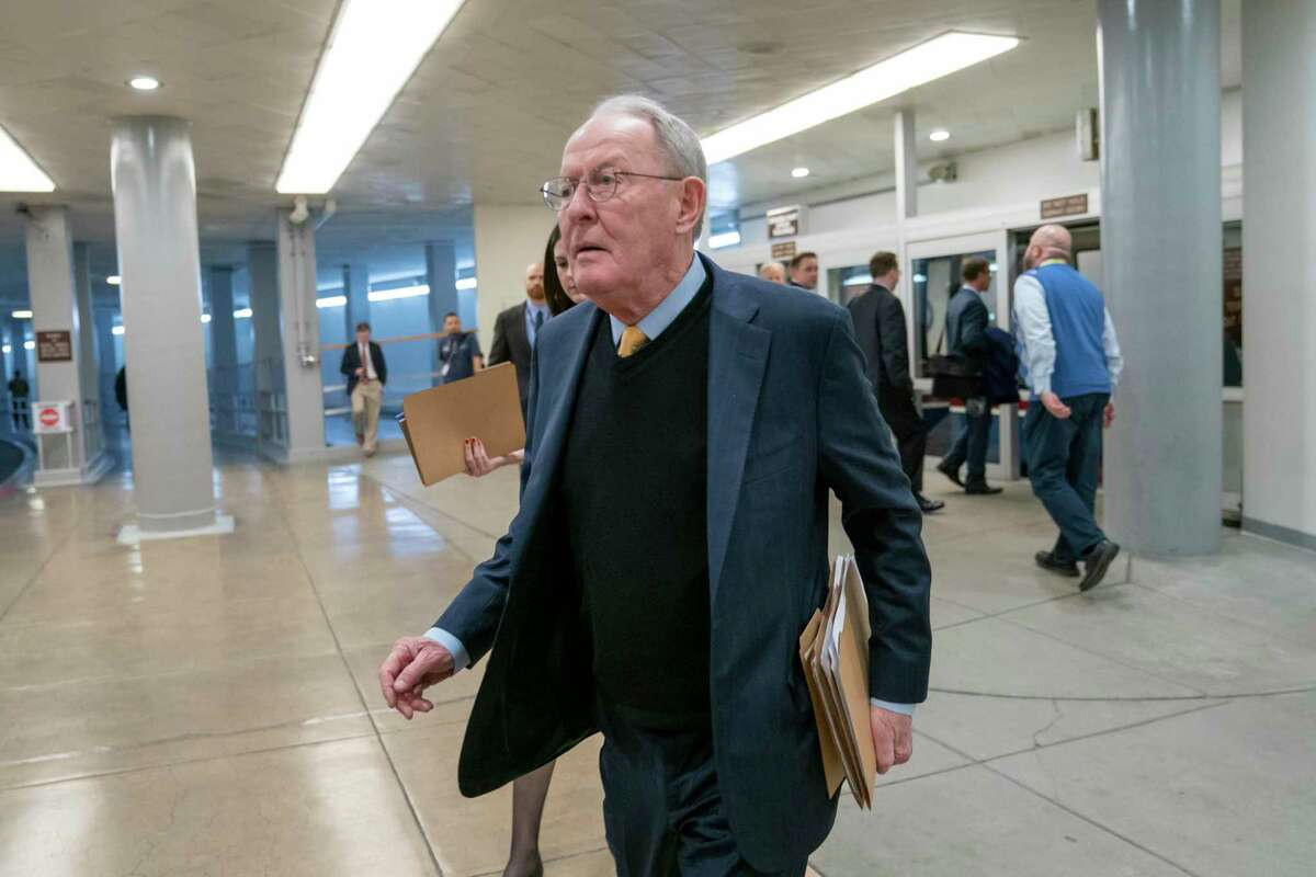 """Sen. Lamar Alexander, R-Tenn., walks to the Senate at the Capitol in Washington, Feb. 12. A new study says about once in every six times someone is taken to an emergency room or checks in to a hospital as an in-patient, the treatment is followed by a """"surprise"""" medical bill."""