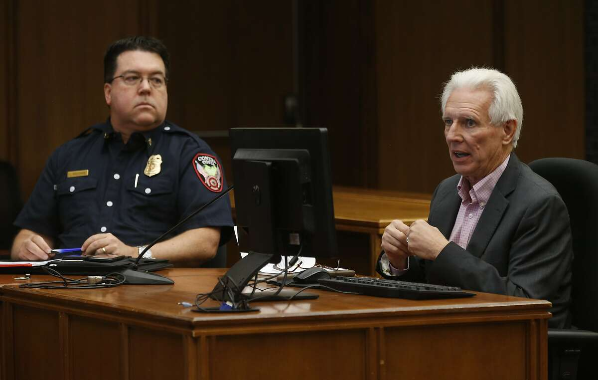 Contra Costa County Fire Chief Lewis Broschard (left) and Randy Sawyer, director of the county's Hazardous Materials Program, appear for a discussion about the NuStar fuel storage tank explosion and fire at a Board of Supervisors meeting in Martinez, Calif. on Tuesday, Oct. 22, 2019.
