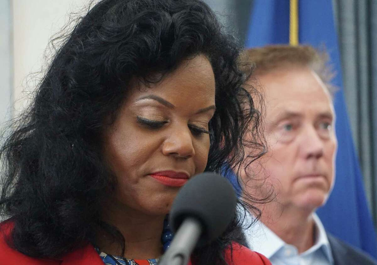 Renée Coleman-Mitchell, commissioner of public health, with Gov. Ned Lamont at a September press conference where they recommended a repeal of the state's religious exemption to vaccines.