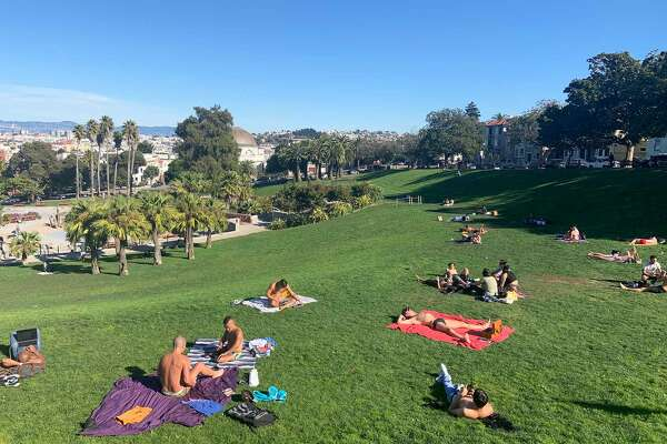 People gather in Dolores Park to soak up some sunshine.