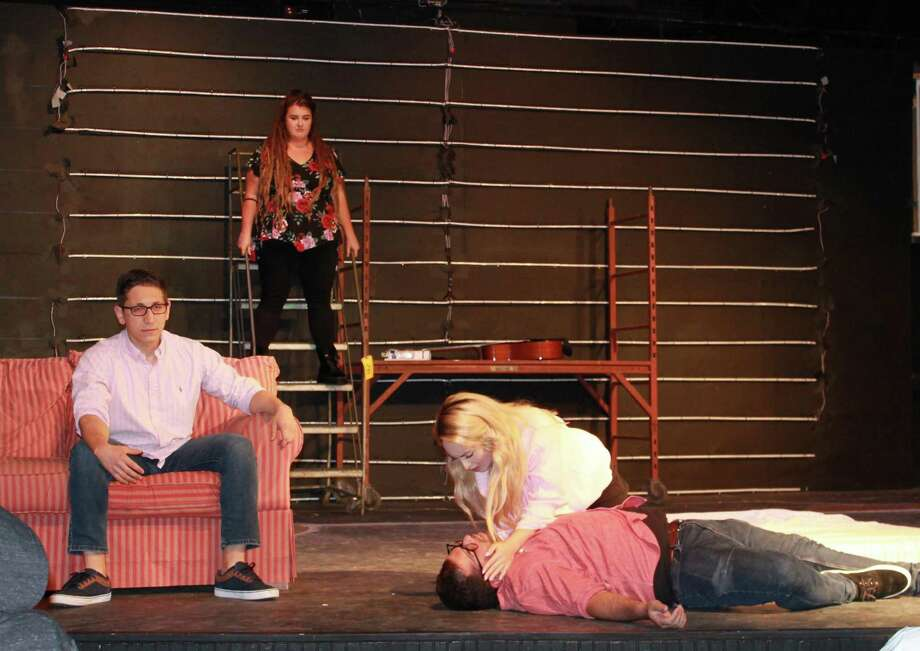 "Noah Leibowitz, Jami Valzania, David Anctil, and Anna Hicks rehearse a scene for Green Day's ""American Idiot,"" onstage at Brookfield Theatre for the Arts, Nov. 1-23. Photo: Contributed Photo"
