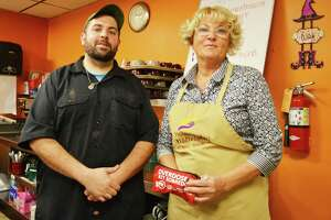 St. Vincent de Paul Middletown Dining Services Manager Lisa Magee-Corvo, right, saved a woman's life Thursday, less than 24 hours after undergoing CPR and Narcan training. She was assisted by head chef Jeremiah Rufini, left, at the Main Street soup kitchen.