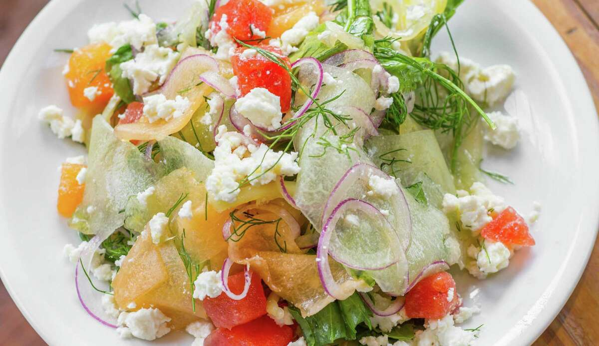 Local melon, backyard basil, herbs, feta, pickled sweet peppers and lime at Coltivare