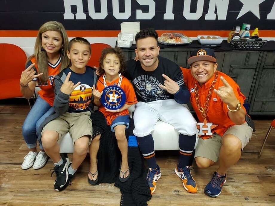 Abigail Arias, Freeport's honorary police officer, and her family visits with Jose Altuve on Tuesday, Oct. 22, before Game 1 of the 2019 World Series. Photo: Courtesy Rey Garivey/Freeport Police Chief