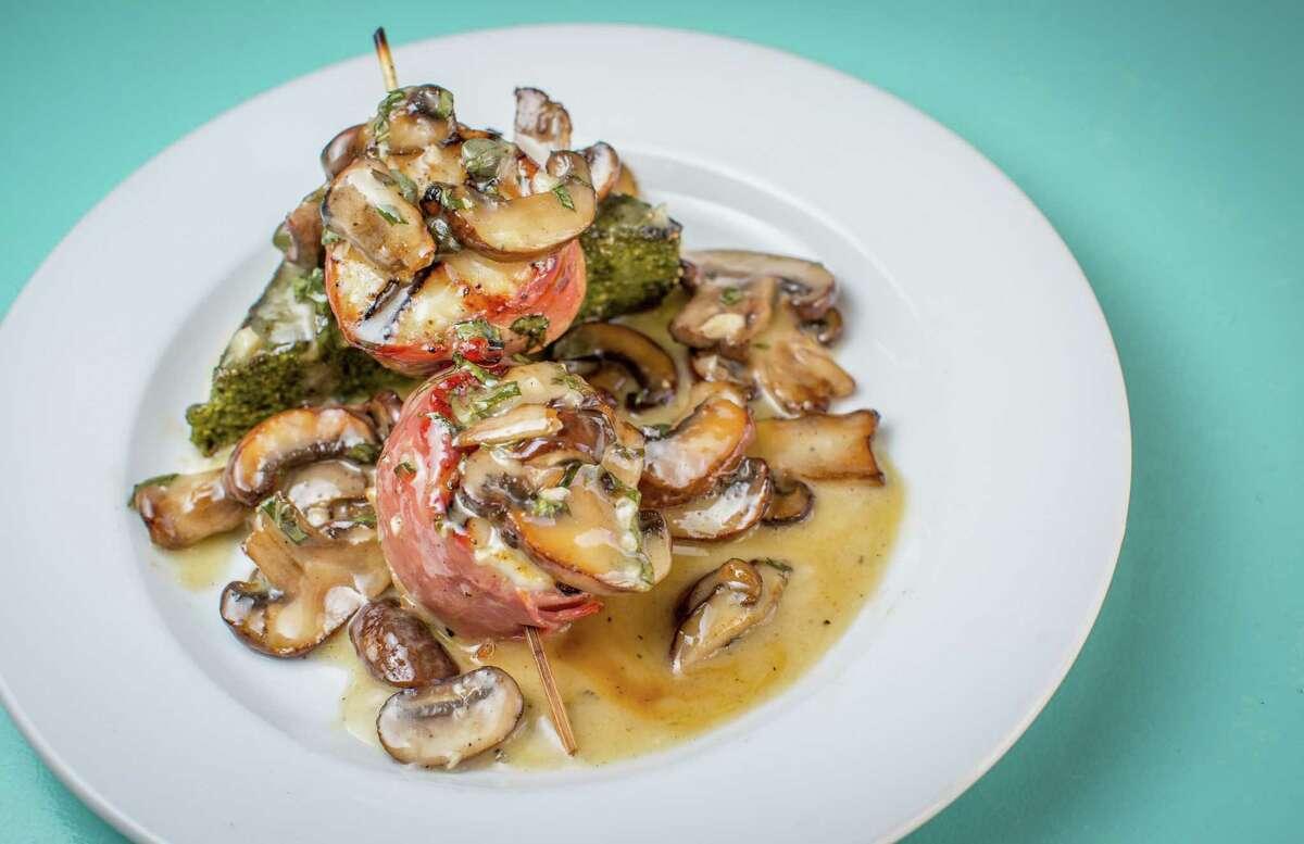 Capesante Con Polenta (grilled diver scallops wrapped in prosciutto served over swiss chard polenta with mushrooms and capers) at Giacomo's Cibo e Vino