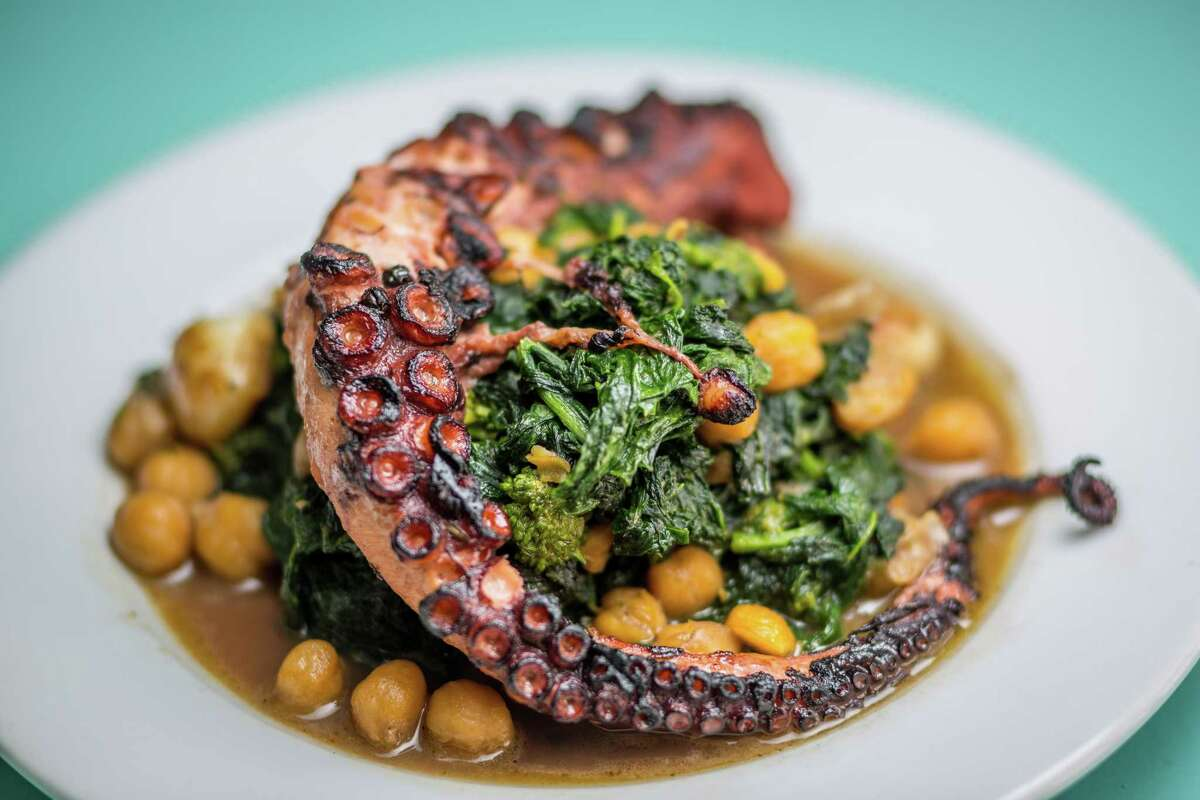 Grilled braised octopus with chickpeas and rapini at Giacomo's Cibo e Vino