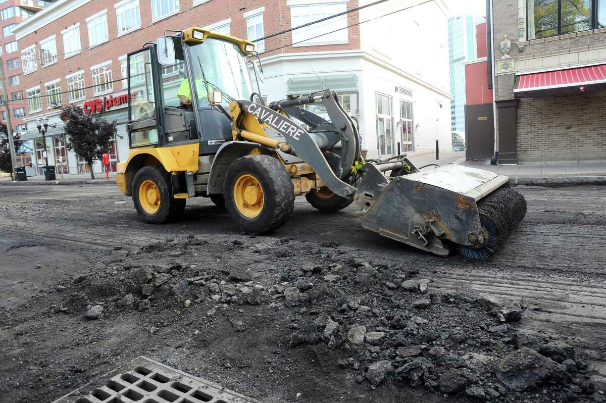 A construction crew paves Forest Street in downtown Stamford, Conn. on Monday, Oct. 23, 2017.