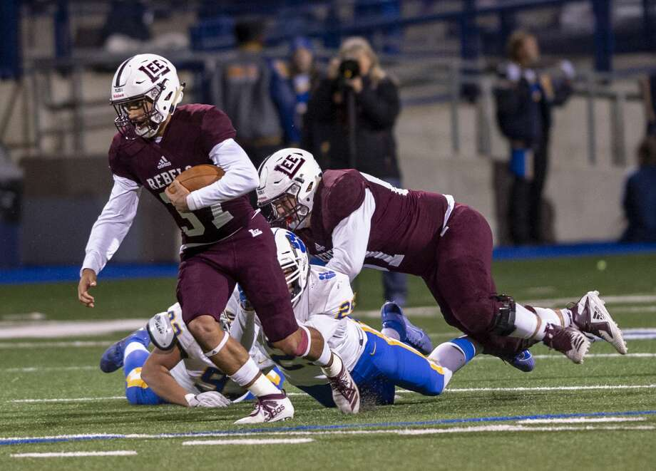 Lee's Zach Heller tackles Frenship's Logan Douglas as Lee's Mikey Serrano carries the ball on Oct. 11, 2019 at Grande Communications Stadium. Photo: Jacy Lewis/Reporter-Telegram