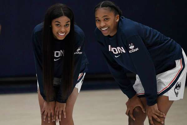 UConn's Evina Westbrook and Aubrey Griffin during the First Night celebration in Storrs on Friday.
