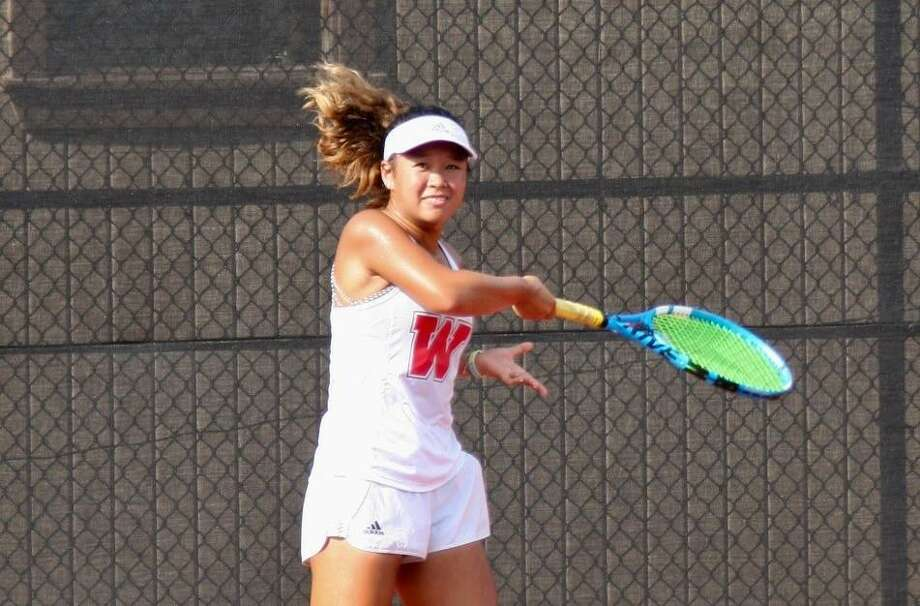 Rachel Sam competes in a tennis match for The Woodlands during the 2019 fall season. Photo: Submitted