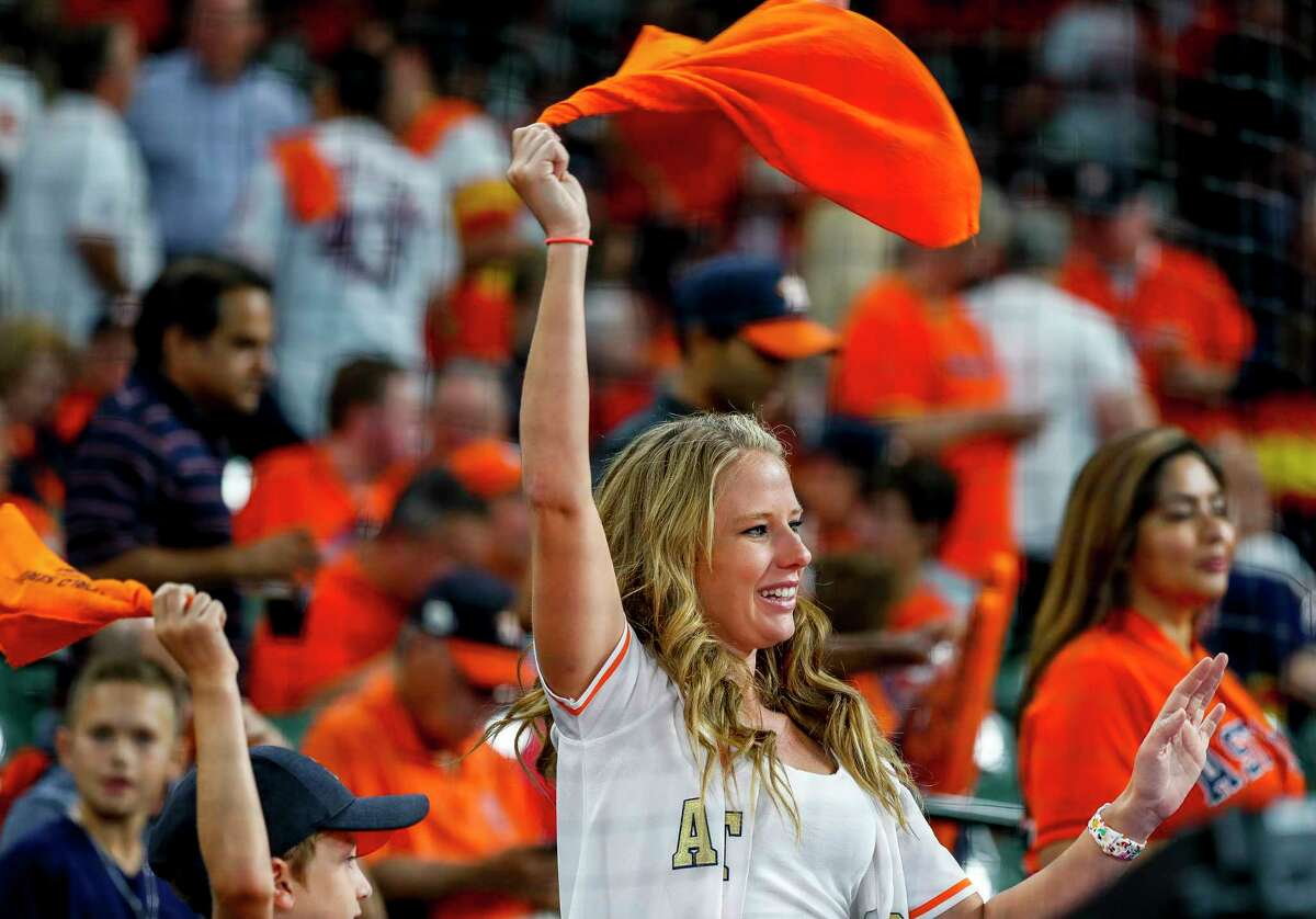 Fans wave their rally towels before Game 1 of the World Series at Minute Maid Park in Houston on Tuesday, Oct. 22, 2019.