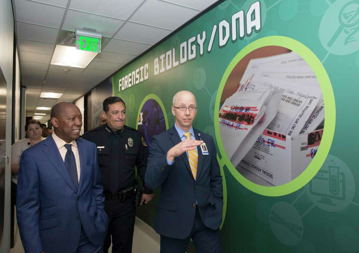 Houston Forensic Science Center CEO and President Dr. Peter Stout, from right, gives Houston Police Chief Art Acevedo and Houston Mayor Sylvester Turner a tour at the new forensic biology lab after a grand opening ceremony on Tuesday, Oct. 22, 2019, in Houston.