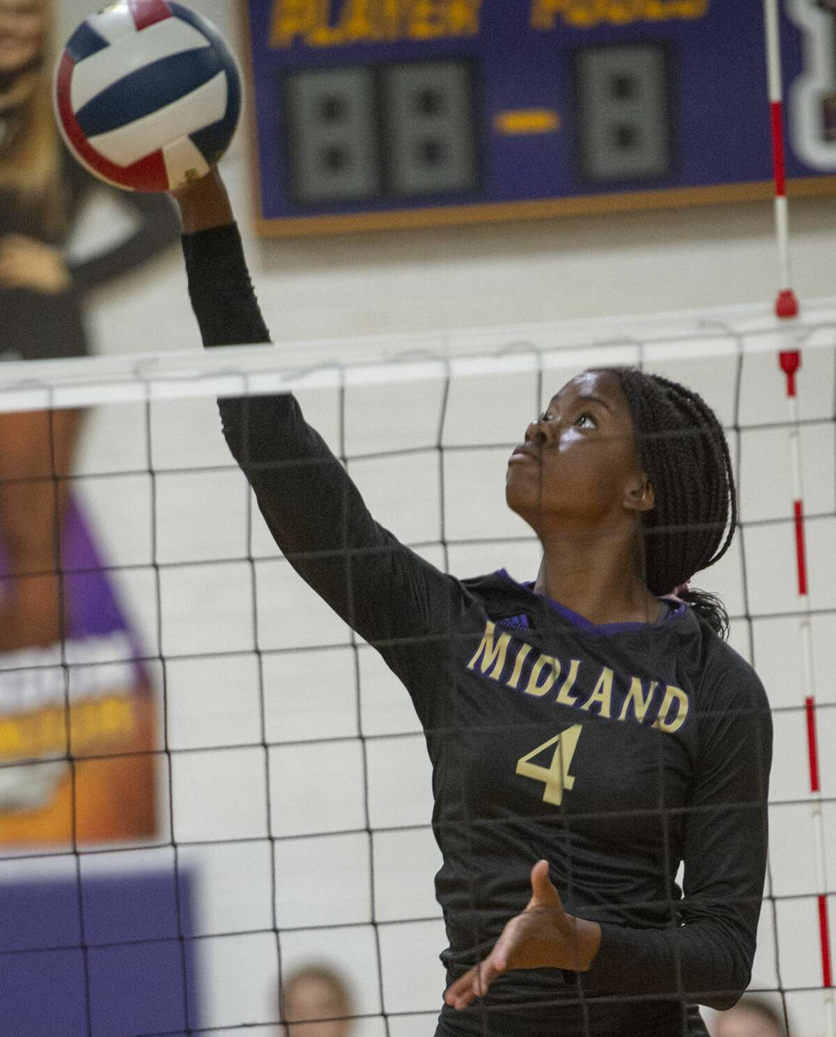 Midland High's Aniya Clinton goes up for a kill 10/22/19 as MHS takes on Odessa High in the Midland High gym. Tim Fischer/Reporter-Telegram