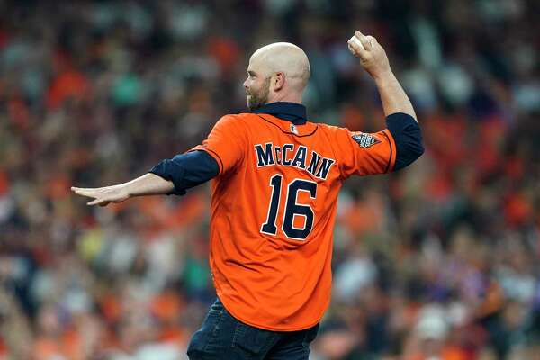 Brian McCann throws out a ceremonial first pitch before Game 1 of the baseball World Series between the Houston Astros and the Washington Nationals Tuesday, Oct. 22, 2019, in Houston.