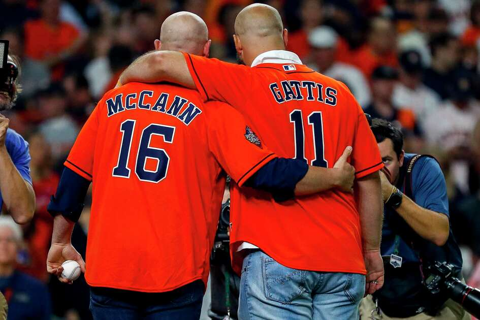 Brian McCann and Evan Gattis take a picture after throwing out the ceremonial first pitch before Game 1 of the World Series at Minute Maid Park in Houston on Tuesday, Oct. 22, 2019.