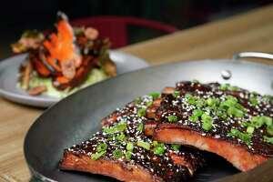 """St. Louis Cut"" sesame-gochujang ribs with barbecue sweet potatoes at International Smoke"