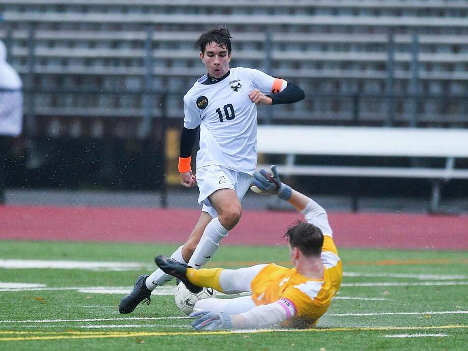 Trumbull's Tiago Frazao (10) plays the ball around Greenwich goalkeeper Padraig Colligan (1) as he attempts to make a save in the first half of a FCIAC league soccer match at Cardinal Stadium in Greenwich, Tuesday, Oct. 22, 2019. Photo: Matthew Brown / Hearst Connecticut Media / Stamford Advocate